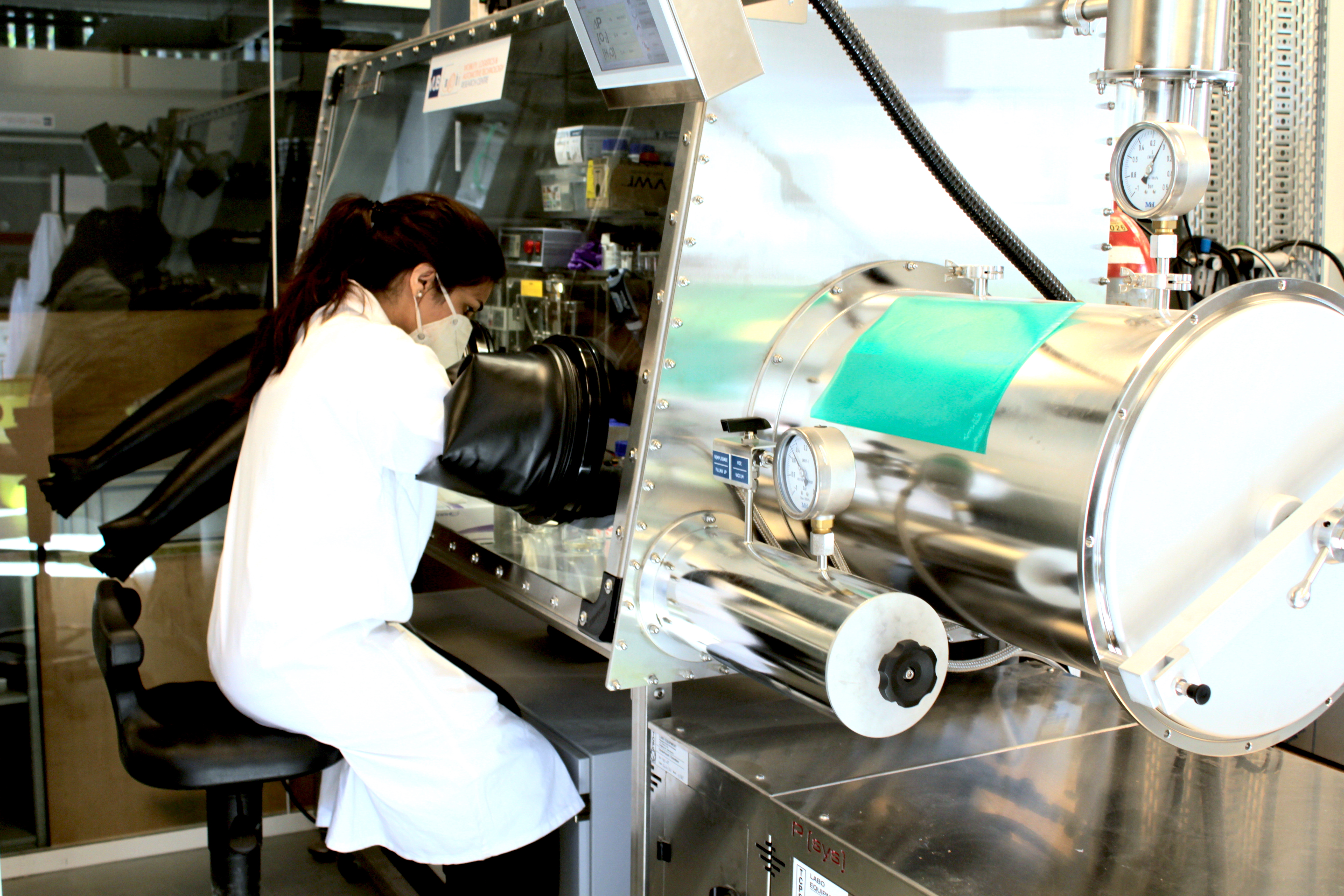 Poonam working with glovebox